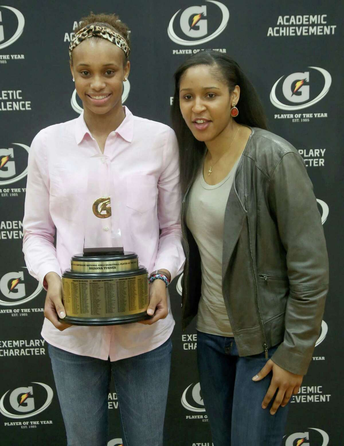 3/20/14: Brianna Turner poses with WNBA player Maya Moore. Manvel's Brianna Turner was named the 2013-14 Gatorade National Girls Basketball Player of the Year. at Manvel High School in Alvin, TX. Presenting the award was 2006-07 player of the year Maya Moore, who plays in the WNBA. and Aminah Charles from Gatorade.