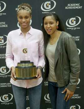 3/20/14: Brianna Turner poses with WNBA player Maya Moore.  Manvel's Brianna Turner was  named the 2013-14 Gatorade National Girls Basketball Player of the Year. at Manvel High School in Alvin, TX.  Presenting the award was 2006-07 player of the year Maya Moore, who plays in the WNBA. and Aminah Charles from Gatorade. Photo: Thomas B. Shea, Houston Chroncile / © 2014 Thomas B. Shea