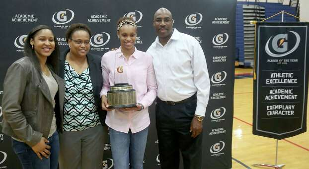 3/20/14: Brianna Turner poses with WNBA player Maya Moore. and her mother Kelly Turner and father Howard Turner. Manvel's Brianna Turner was  named the 2013-14 Gatorade National Girls Basketball Player of the Year. at Manvel High School in Alvin, TX.  Presenting the award was 2006-07 player of the year Maya Moore, who plays in the WNBA. and Aminah Charles from Gatorade. Photo: Thomas B. Shea, Houston Chroncile / © 2014 Thomas B. Shea