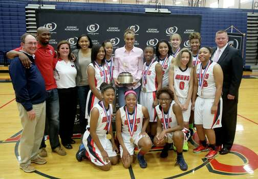 3/20/14: Brianna Turner poses with WNBA player Maya Moore, her coach Bryan Harris, far right and her teammates. Manvel's Brianna Turner was  named the 2013-14 Gatorade National Girls Basketball Player of the Year. at Manvel High School in Alvin, TX.  Presenting the award was 2006-07 player of the year Maya Moore, who plays in the WNBA. and Aminah Charles from Gatorade. Photo: Thomas B. Shea, Houston Chroncile / © 2014 Thomas B. Shea