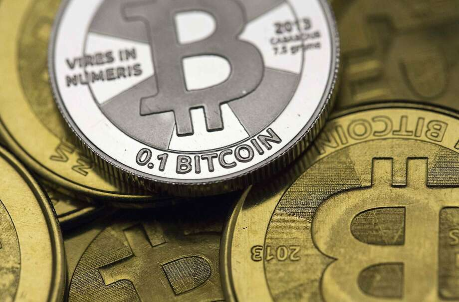 Bitcoin is a currency that is exchanged through the use of computer code. Banks are looking at how transactions are conducted with the virtual money. Photo: Jim Urquhart, Reuters