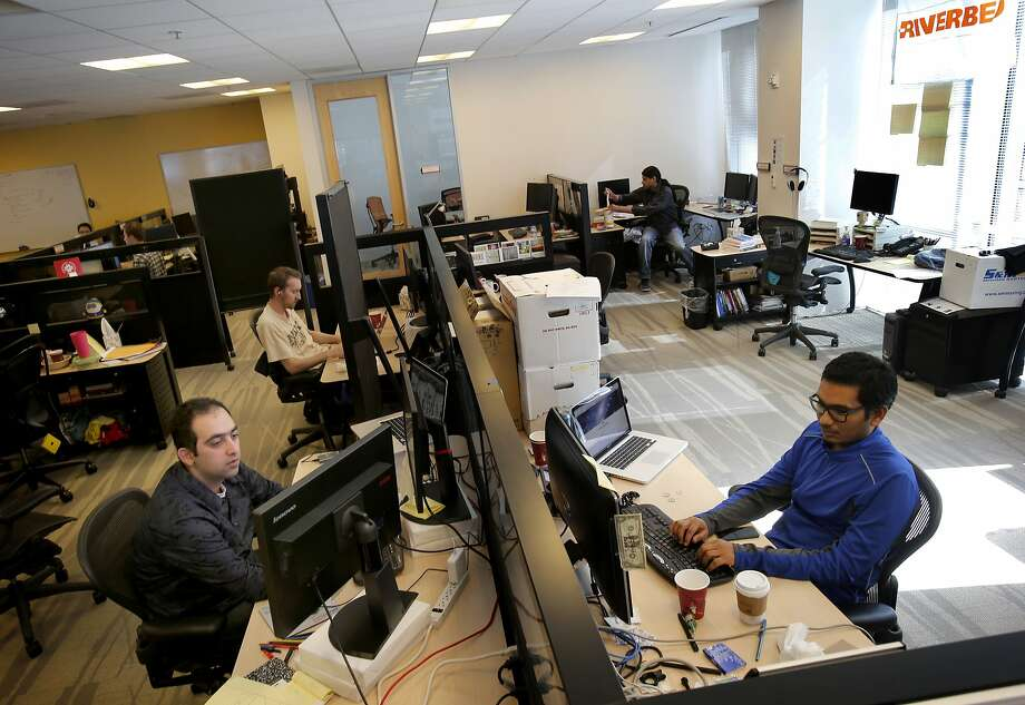 Engineers work at the San Francisco offices of Riverbed Technology, where they enjoy coffee, tea, soda and snacks but few of the benefits that are provided to employees at most big tech companies. Photo: Brant Ward, The Chronicle