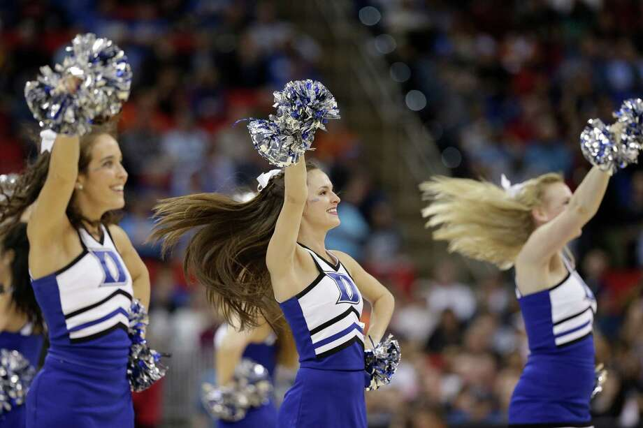 Duke cheerleaders perform during the first half of an NCAA college basketball second-round game against Mercer , Friday, March 21, 2014, in Raleigh, N.C. (AP Photo/Chuck Burton) Photo: Chuck Burton, Associated Press / AP