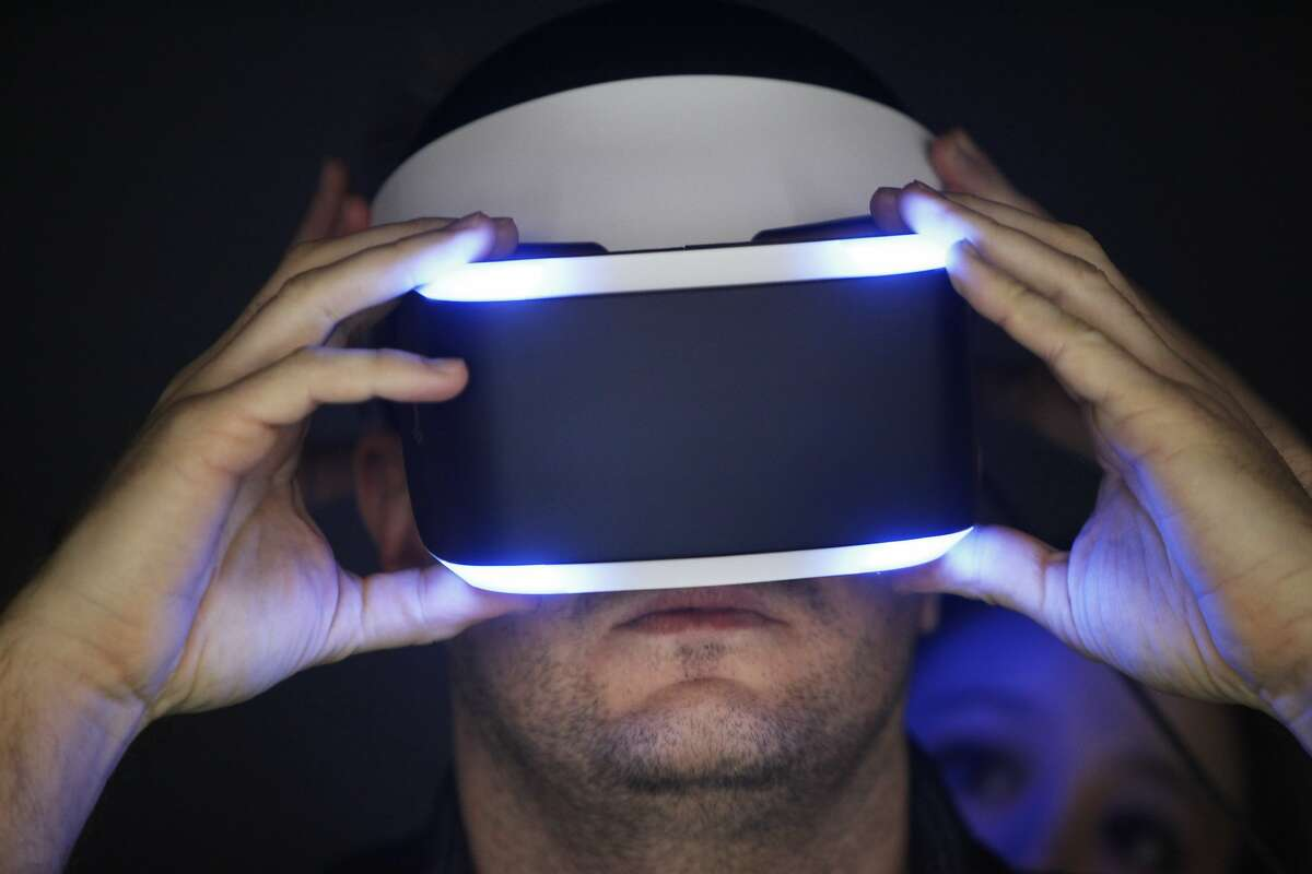 Mikko Toivanen tries out Project Morpheus, a virtual reality headset made by Sony for PlayStation at the Game Developers Conference on March 19, 2014 in San Francisco, Calif.