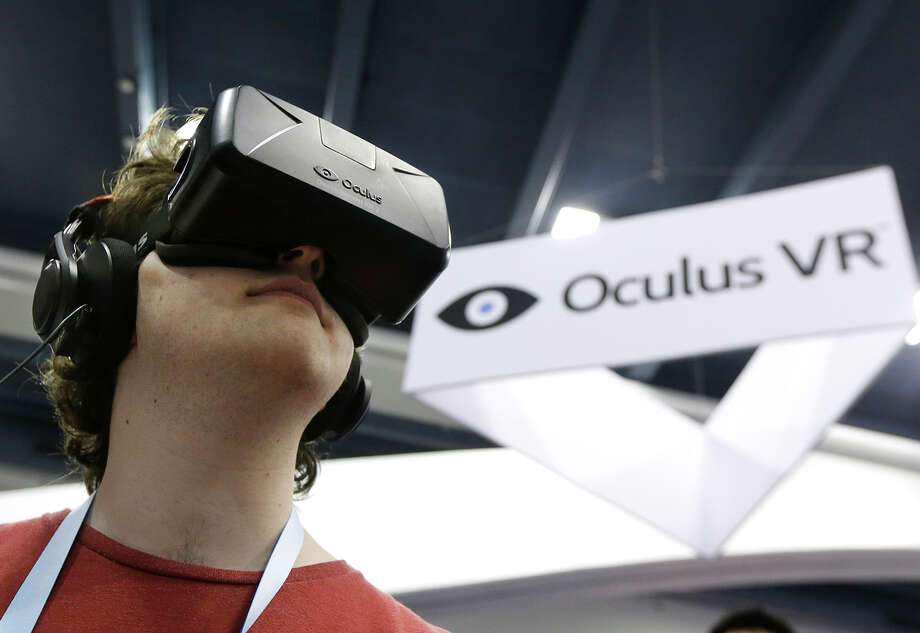 Peter Mason tries the Oculus virtual reality headset at last year's conference. Oculus used the show to show off a second-generation Rift development kit. Photo: Jeff Chiu / Associated Press / AP