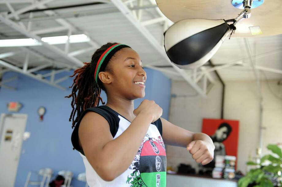 Autum Ashante, a 15-year-old boxer and student at Norwalk Community College, prepares for a qualifying fight for the Golden Gloves competition training at Revolution Training in Stamford, Conn. on Friday March 21, 2014. Photo: Dru Nadler / Stamford Advocate Freelance