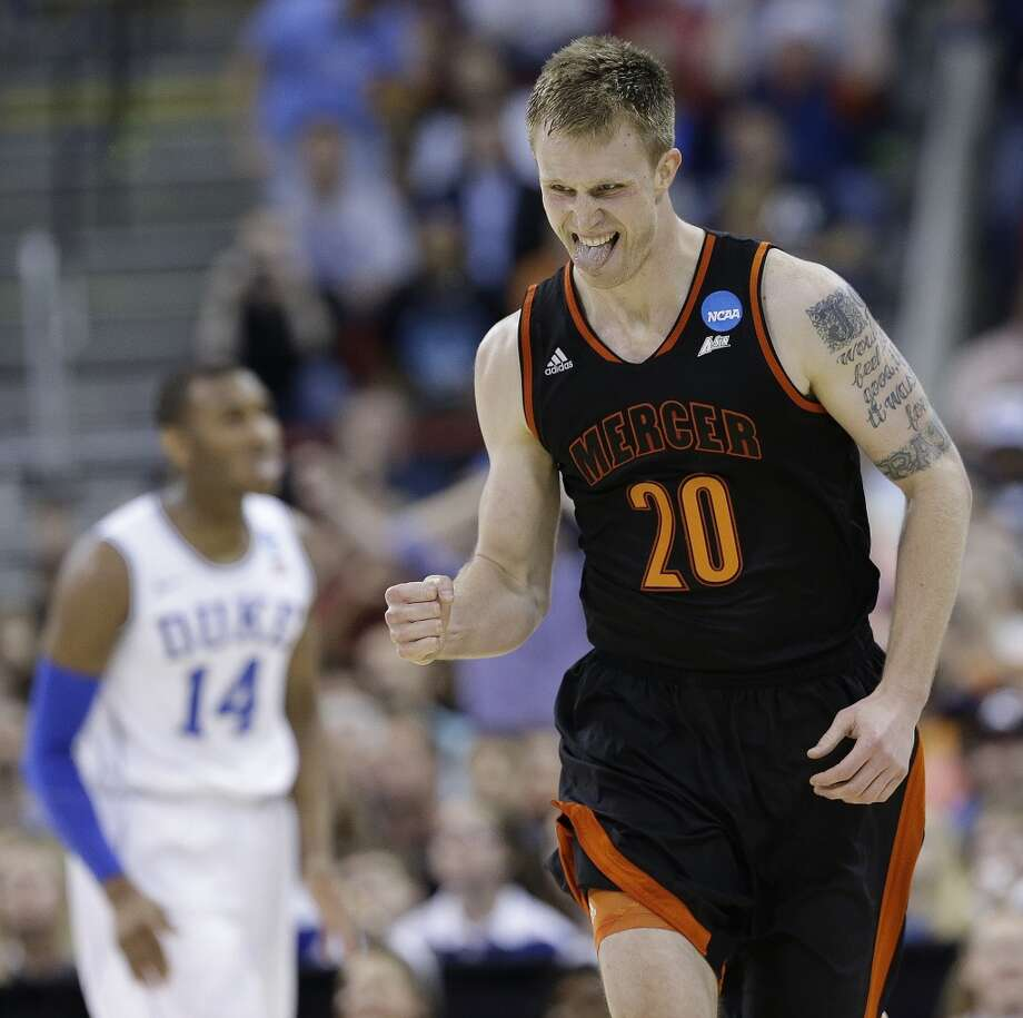 March 21: Second round  No. 14 Mercer 78, No. 3 Duke 71 Mercer forward Jakob Gollon celebrates a basket during the first half. Photo: Gerry Broome, Associated Press