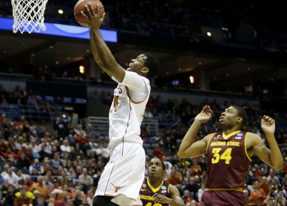 Second round March 20:  No. 7 Texas 87, Arizona State 85 Martez Walker of the Longhorns drives against the Sun Devils. Photo: Mike McGinnis, Getty Images