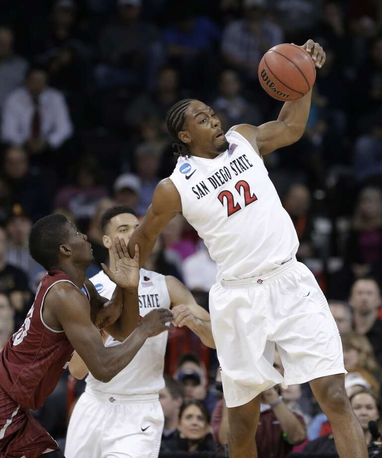 Second round March 20:  No. 4 San Diego State 73, New Mexico State 69 (OT) Josh Davis of the Aztecs corrals a loose ball. Photo: Elaine Thompson, Associated Press