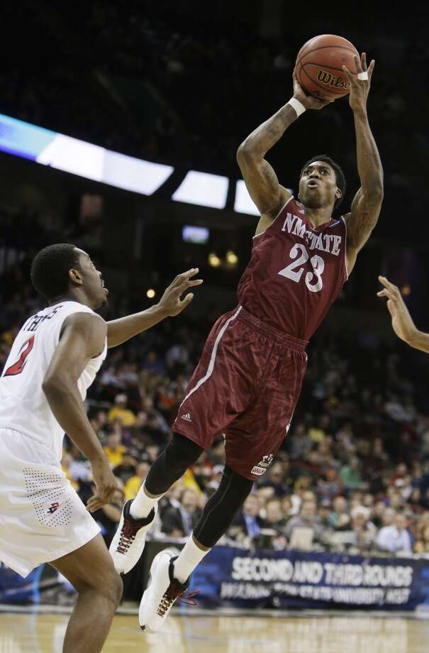 Daniel Mullings of New Mexico attempts a shot against San Diego State. Photo: Young Kwak, Associated Press