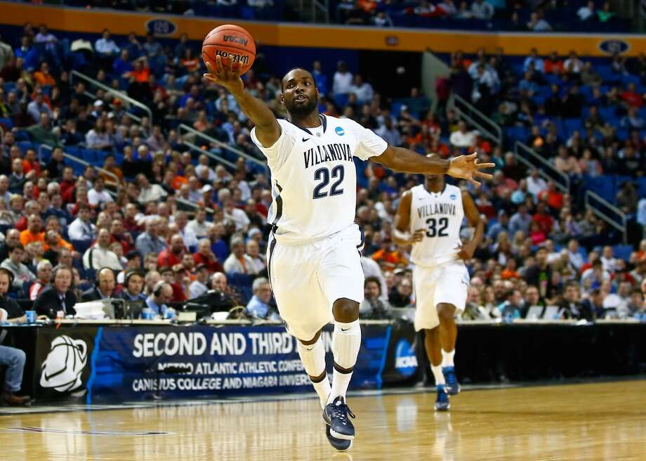 Second round March 20: No. 2 Villanova 73, Milwaukee 53 JayVaugn Pinkston of the Wildcats tracks down the ball against the Panthers. Photo: Jared Wickerham, Getty Images
