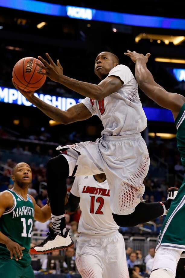 Second round March 20: No. 4 Louisville 71, Manhattan 64  Terry Rozier of the Cardinals drives against the Jaspers. Photo: Kevin C. Cox, Getty Images