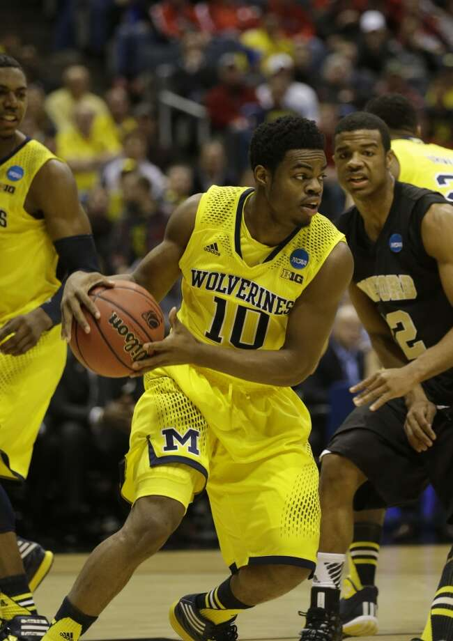 Second round March 20: No. 2 Michigan 57, Wofford 40 Derrick Walton Jr. of the Wolverines drives against the Terriers. Photo: Jeffrey Phelps, Associated Press
