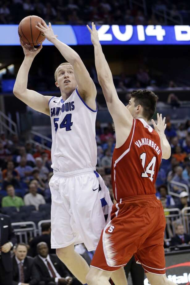 John Manning of Saint Louis attempts a shot against North Carolina State. Photo: John Raoux, Associated Press