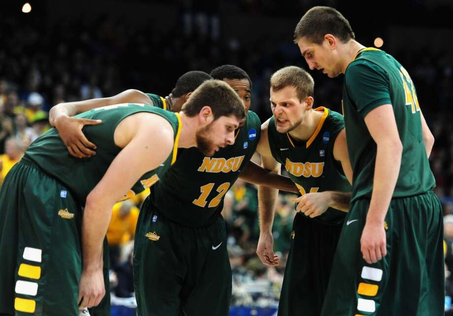 Second round March 20: No. 12 North Dakota State 80, Oklahoma 75 (OT)  Bison players huddle up while playing the Sooners. Photo: Steve Dykes, Getty Images