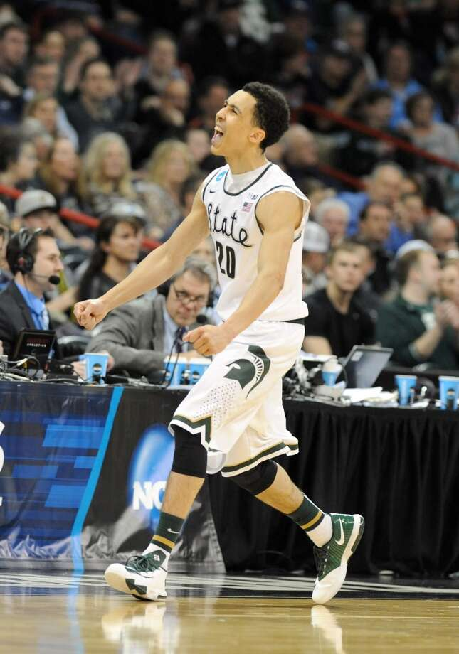 Second round March 20: No. 4 Michigan State 93, Delaware 78  Travis Trice of the Spartans reacts after making a basket. Photo: Steve Dykes, Getty Images