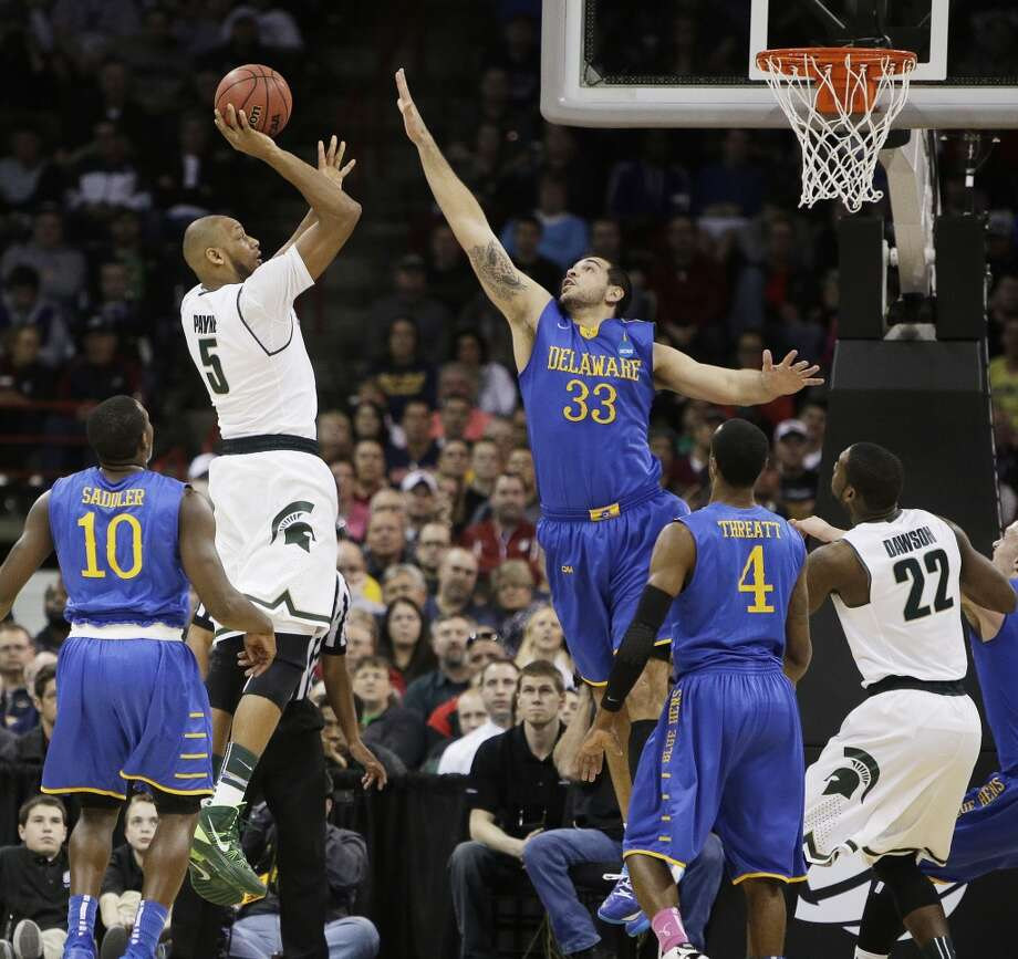Adreian Payne of Michigan State attempts a shot over Carl Baptiste of Delaware. Photo: Young Kwak, Associated Press