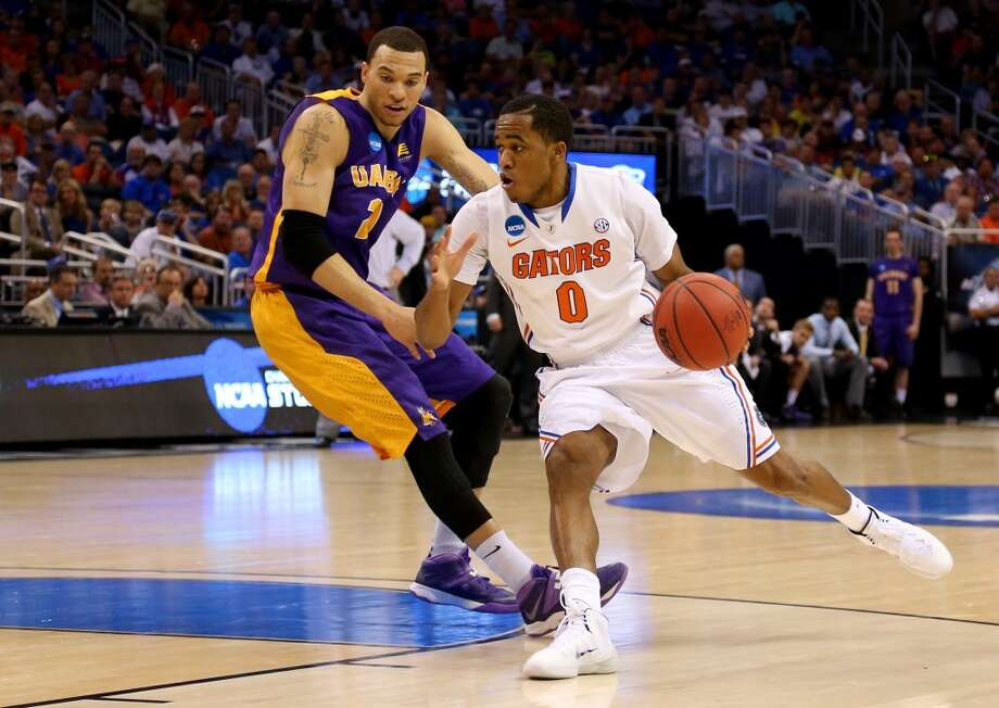 Second round March 20: No. 1 Florida 67, Albany 55  Kasey Hill of the Gators drvies against Gary Johnson of the Great Danes. Photo: Mike Ehrmann, Getty Images