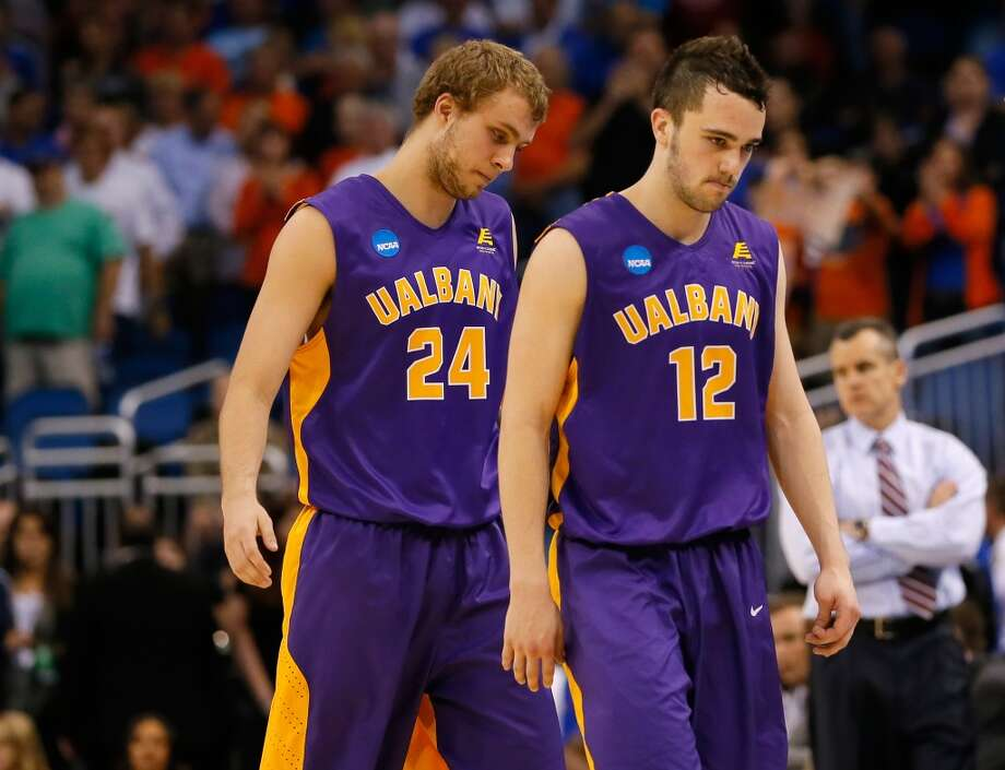 Peter Hooley and Dallas Ennema of Albany leave the court dejected after being eliminated by Florida. Photo: Kevin C. Cox, Getty Images