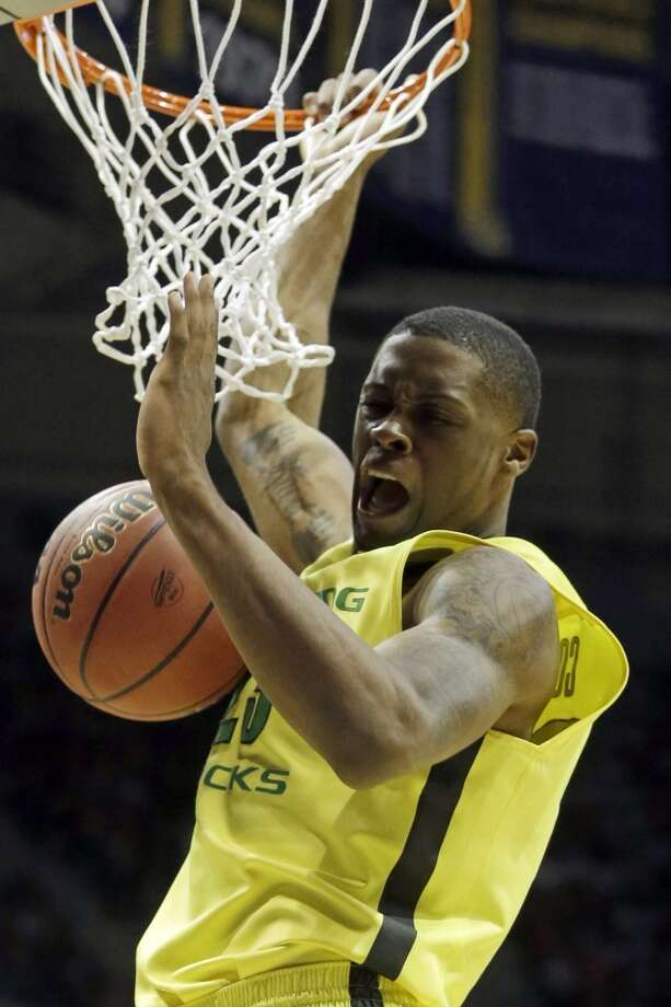 Second round March 20: No. 7 Oregon 87, BYU 68 Oregon forward Elgin Cook throws down two of his game-high 23 points. Photo: Morry Gash, Associated Press