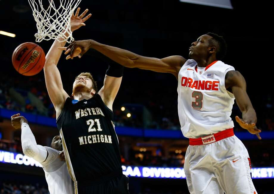 Second round March 20: No. 3 Syracuse 77, Western Michigan 53 Syracuse's Jerami Grant blocks a shot by Western Michigan's Shayne Whittington. Photo: Jared Wickerham, Getty Images