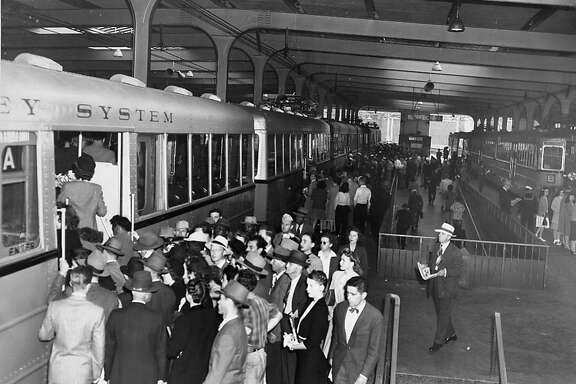Travelers in 1939 board a Key System train inside the Transbay Terminal in San Francisco.