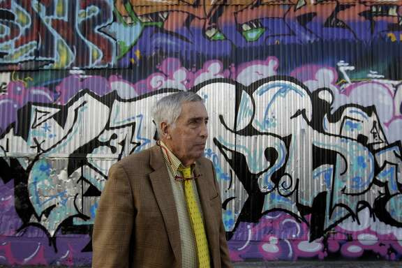 Property owner Larry Mathews views the work of taggers and graffiti artists defacing buildings on Erie Alley in San Francisco, Calif. on Thursday, March 20, 2014. Mathews says he spends $15,000 annually to cover graffiti on his building and is not happy with the city's current graffiti eradication policy.