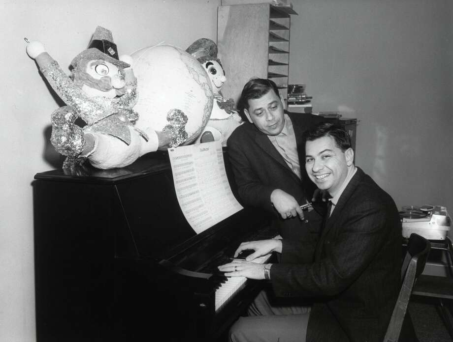 "The Academy Award-winning songwriting team of Richard Sherman (right) and Robert Sherman rehearse their song, ""It's a small world,"" in their offices at The Walt Disney Studios in this 1964 photo. The song is purported to be one of the most performed and recognized songs in the world, and has become both a beloved and parodied pop culture song staple. Disney Parks is celebrating the 50th anniversary of its iconic ""it's a small world"" attraction with a global celebration that benefits UNICEF. Photo: Disney Parks"