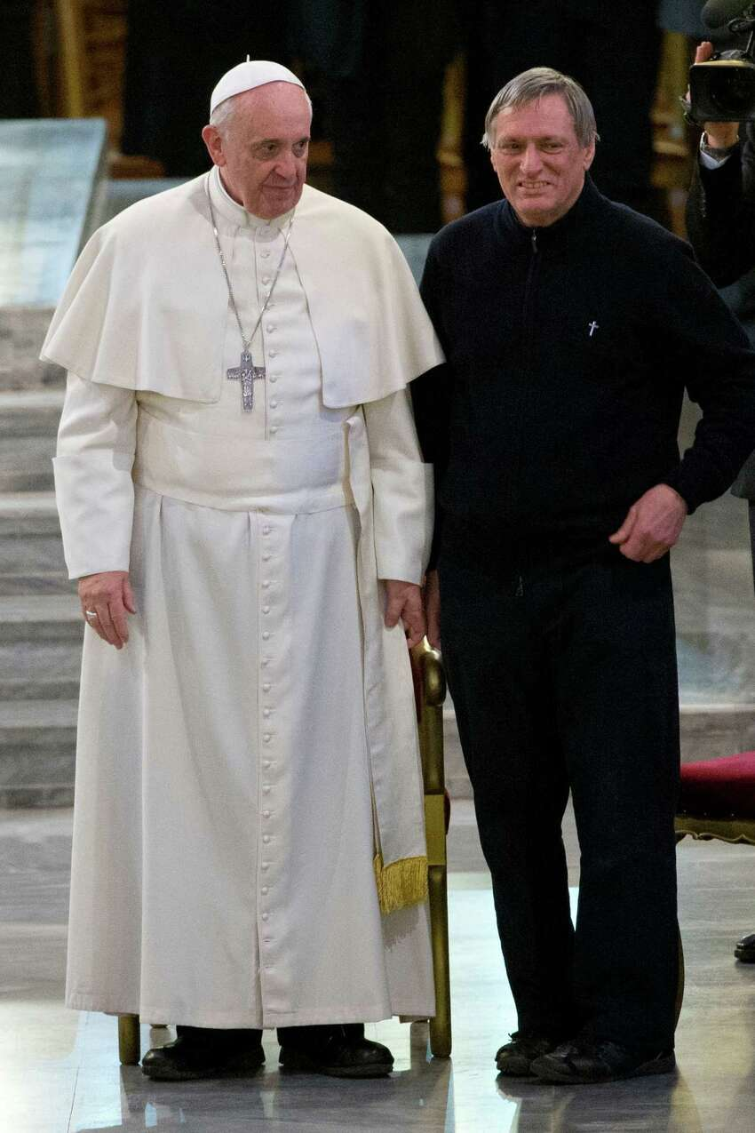 He excommunicated the mafia and all mobsters everywhere. PHOTO: Pope Francis and Don Luigi Ciotti attend a meeting with relatives of innocent mafia victims, in Rome's St. Gregorio VII church, just outside the Vatican, Friday, March 21, 2014.