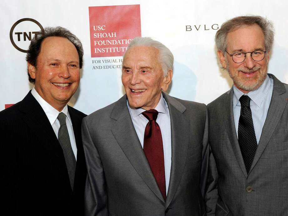 "FILE - In this Oct. 21, 2008 file photo, honoree Kirk Douglas, center, with host Billy Crystal, left, and event chair Steven Spielberg, attend the USC Shoah Foundation Institute's Ambassador for Humanity gala at the California Science Center in Los Angeles. When Spielberg started the foundation in 1994, he just wanted to collect survivor testimonies to help silence the Holocaust deniers who'd popped up during the making of ""Schindler's List."" He never expected to get nearly 51,413 accounts in 34 languages from 58 countries. (AP Photo/Kevork Djansezian, file) ORG XMIT: CAET883 Photo: Kevork Djansezian / AP"