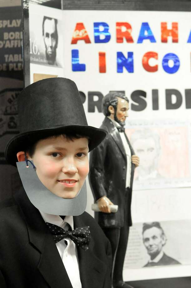 """He stole the beard from the junior varsity hockey goalie:Seventh-grader Derrick Bradley   portrays Abraham Lincoln during the """"living"""" wax museum at East Carter Middle School in   Grayson, Ky. Photo: Kevin Goldy, Associated Press"""