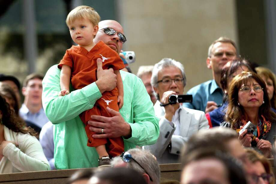 Marcelano Alcanter, 4, stands on a rail with his father, Todd, watching Match Day for his mother, medical student Wendy Alcanter, at the University of Texas Health Science Center Medical School Friday, March 21, 2014, in Houston. Match Day is the culmination of a complex precess that matches graduating medical students with residency programs through the National Resident Matching Program. UT Health matched 231 students, with 49 percent staying in Texas. Photo: Brett Coomer, Houston Chronicle / © 2014 Houston Chronicle
