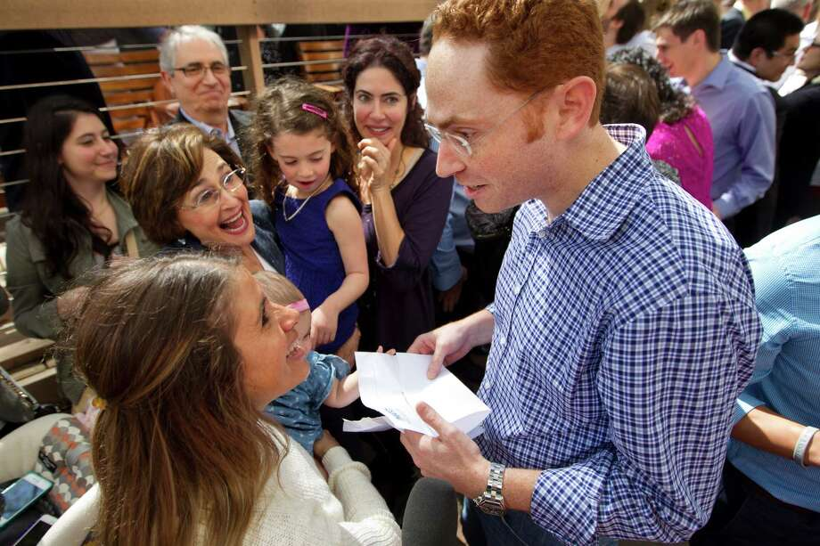 Medical student Marshall Lerman is surrounded by his family, including his wife, Amy, left, as he opens his Match Day letter at the University of Texas Health Science Center Medical School Friday, March 21, 2014, in Houston. Match Day is the culmination of a complex precess that matches graduating medical students with residency programs through the National Resident Matching Program. UT Health matched 231 students, with 49 percent staying in Texas. Photo: Brett Coomer, Houston Chronicle / © 2014 Houston Chronicle