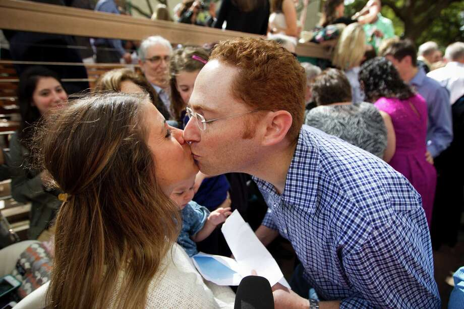 Medical student Marshall Lerman kisses his wife, Amy after opening Match Day letter at the University of Texas Health Science Center Medical School Friday, March 21, 2014, in Houston. Match Day is the culmination of a complex precess that matches graduating medical students with residency programs through the National Resident Matching Program. UT Health matched 231 students, with 49 percent staying in Texas. Photo: Brett Coomer, Houston Chronicle / © 2014 Houston Chronicle