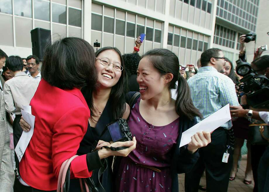 Fourth-year medical student Kathleen Jia center, is congratulated by fellow classmate Lauren Jeang right, and Jia's mother Yanfang Liu left, after Jia learned she was accepted to Stanford University during Match Day celebration at Baylor College of Medicine where the students learn where they've been chosen to do their residency training Friday, March 21, 2014, in Houston. Photo: James Nielsen, Houston Chronicle / © 2014  Houston Chronicle