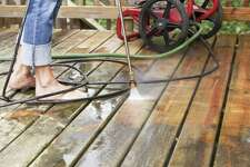 Use a pressure washer to freshen a weathered deck.