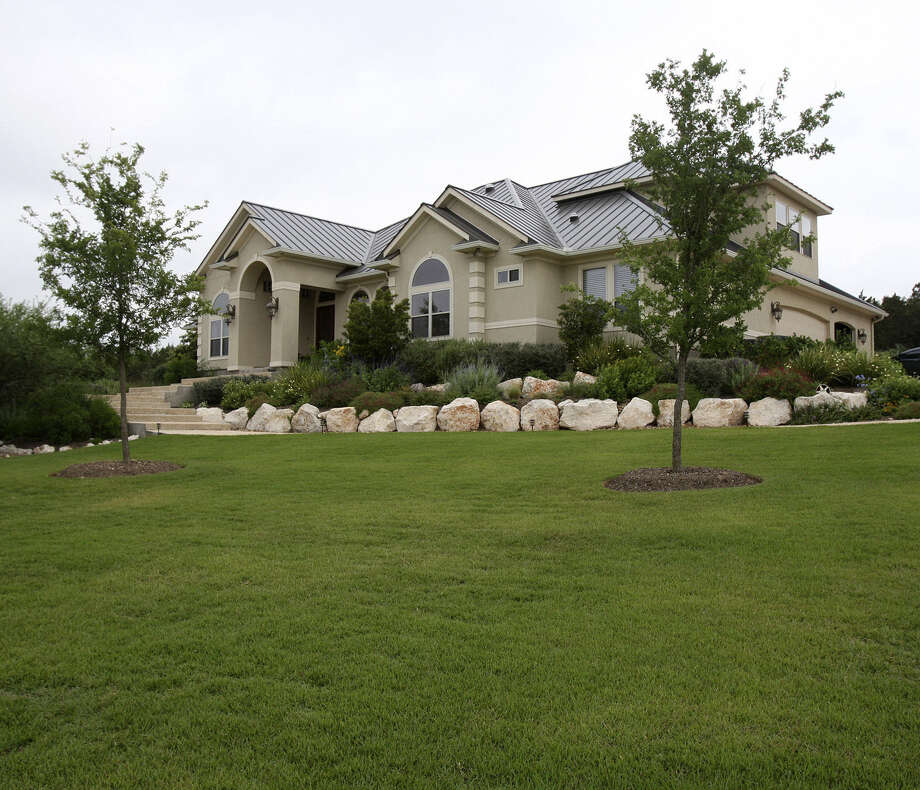 Healthy lawns require a deep layer of soil. If extra soil is needed, skip the topsoil and buy a pasteurized soil mix that is weed-free. Photo: Express-News File Photo / hmontoya@express-news.net