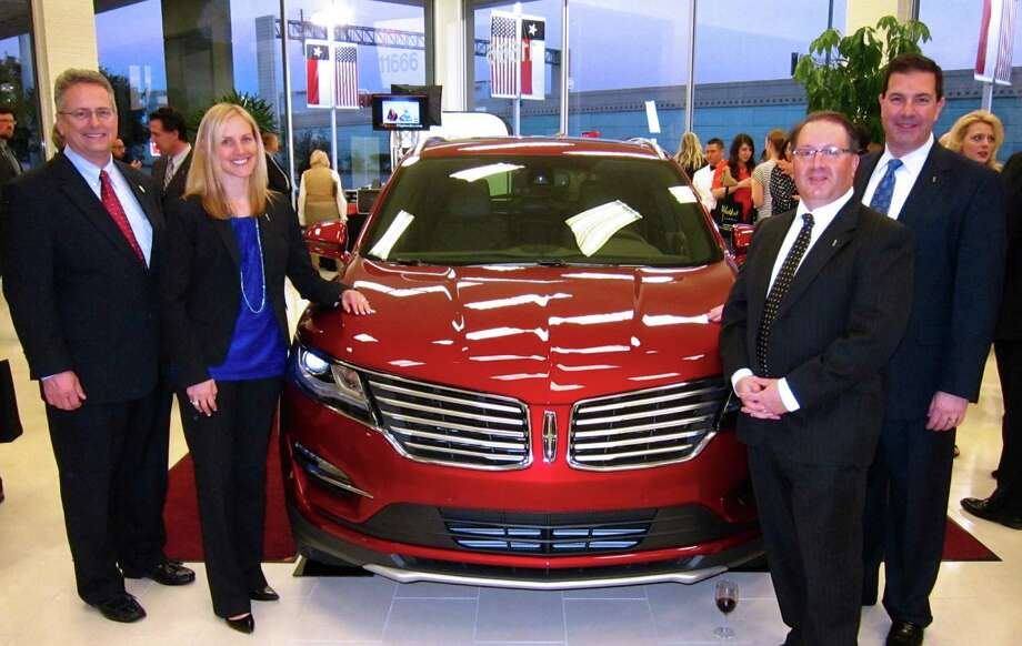 The upcoming Lincoln MKC made a splash at the party celebrating  West Point Lincoln's stylish redesign. With the 2015 luxury crossover were, left to right, Becca Anderson, Lincoln area manager;  Bill Flynn, general manager of Ford's central market area; Larry A. Gach, regional manager of sales for Ford's Houston region and West Point Lincoln's vice president and general manager Chris Poulos.