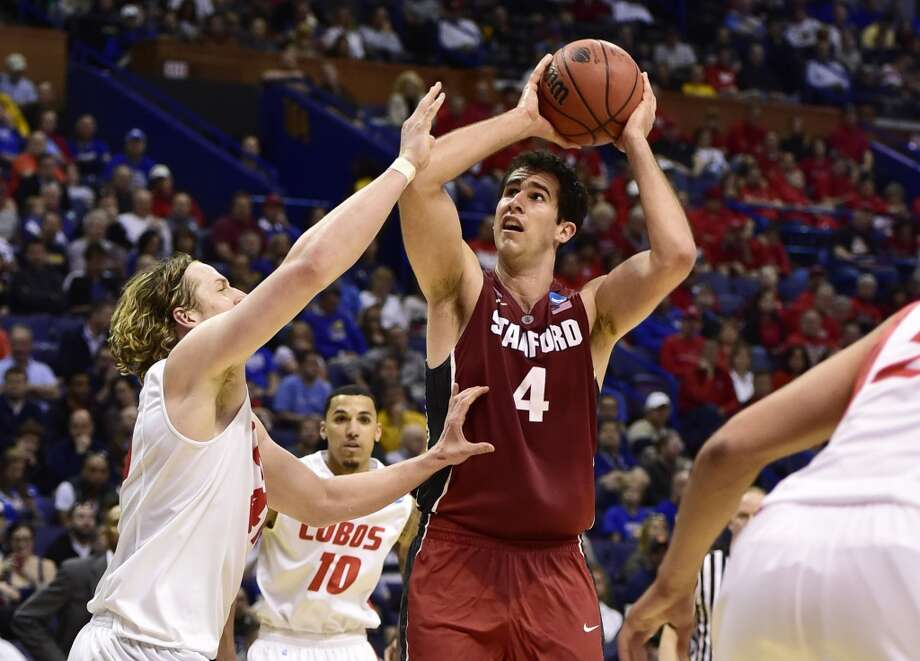 Stanford Cardinal center Stefan Nastic puts up a shot defended by New Mexico Lobos forward Cameron Bairstow in the second half during the 2nd round of the 2014 NCAA Men's  Basketball Championship at Scottrade Center. Photo: Scott Rovak, Reuters