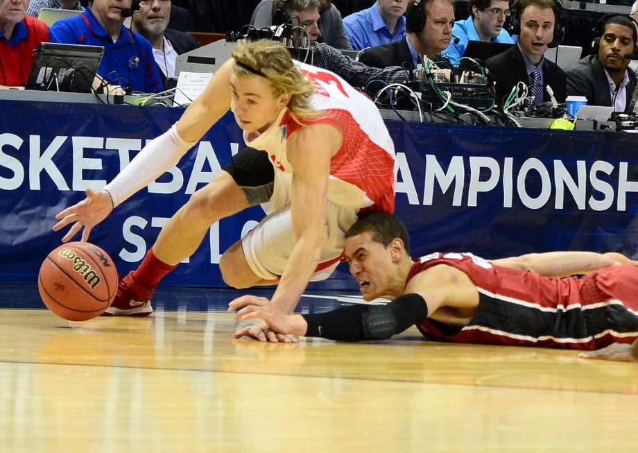 New Mexico Lobos guard Hugh Greenwood (3) battles for a loose ball with Stanford Cardinal forward Dwight Powell (33) in the second half during the 2nd round of the 2014 NCAA Men's Basketball Championship at Scottrade Center. Photo: Jasen Vinlove, Reuters