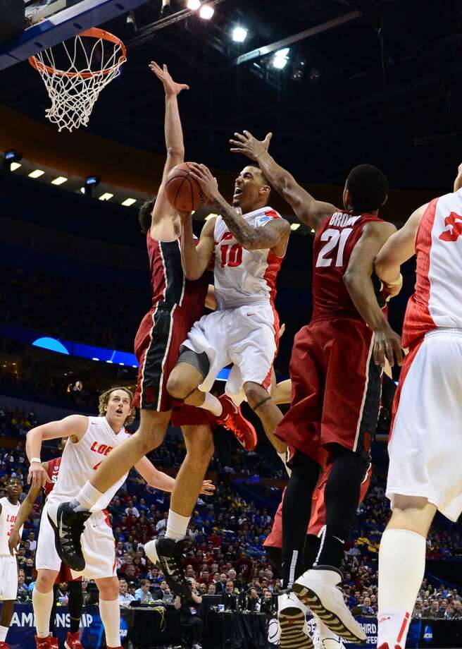 New Mexico Lobos guard Kendall Williams (10) drives to the basket between Stanford Cardinal center Stefan Nastic (4) and Anthony Brown (21) in the second half during the 2nd round of the 2014 NCAA Men's Basketball Championship at Scottrade Center. Photo: Jasen Vinlove, Reuters