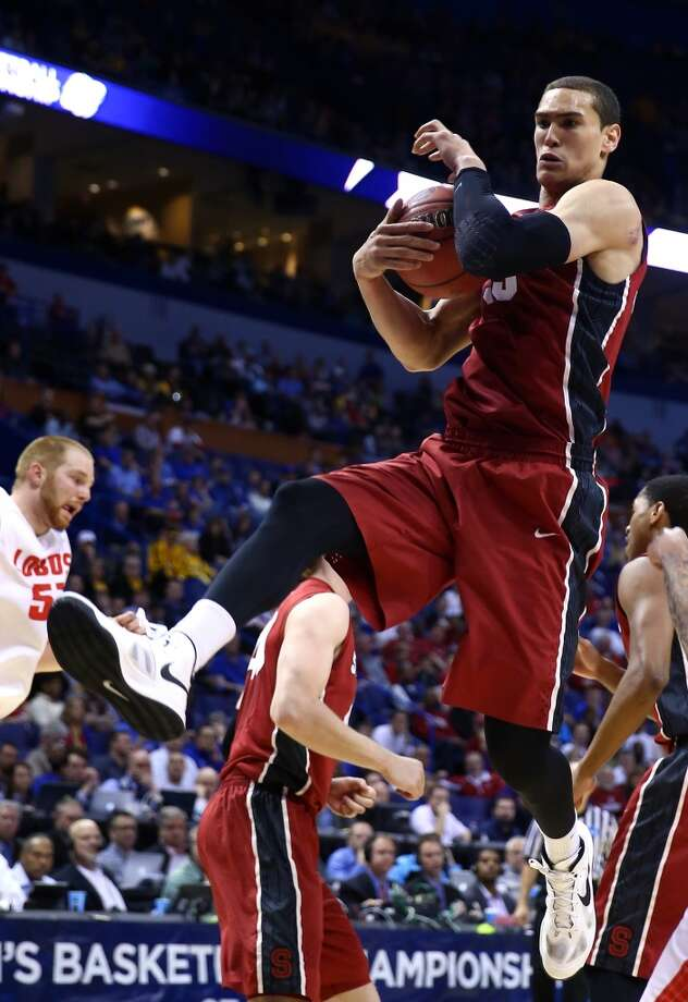 Dwight Powell #33 of the Stanford Cardinal rebounds the ball against the New Mexico Lobos  during the second round of the 2014 NCAA Men's Basketball Tournament at Scottrade Center on March 21, 2014 in St Louis, Missouri. Photo: Andy Lyons, Getty Images