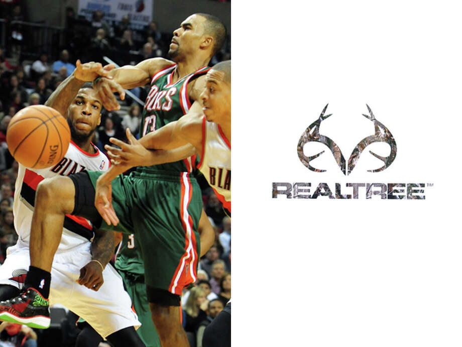 Milwaukee Bucks / RealTree: RealTree already has the buck antlers built into its logo. Plus, if you played for the Bucks you'd be looking for camo or any other option for hiding. Photo: STEVE DYKES, AP / FR155163 AP