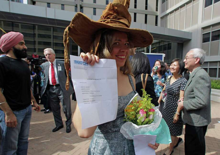 Fourth-year medical student Giselle Dutcher holds her acceptance letter to Emory University during Match Day celebration at Baylor College of Medicine where the students learn where they've been chosen to do their residency training Friday, March 21, 2014, in Houston. Photo: James Nielsen, Houston Chronicle / © 2014  Houston Chronicle