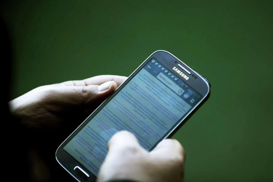 Federal legislation moving through the U.S. Senate that would require new cell phones and smartphones to have a device that would allow a phone true owner to lock or delete all of the information from the phone. Photo: BULENT KILIC, AFP/Getty Images / 2014 AFP BULENT KILIC/AFP/Getty Images connecticut post contributed