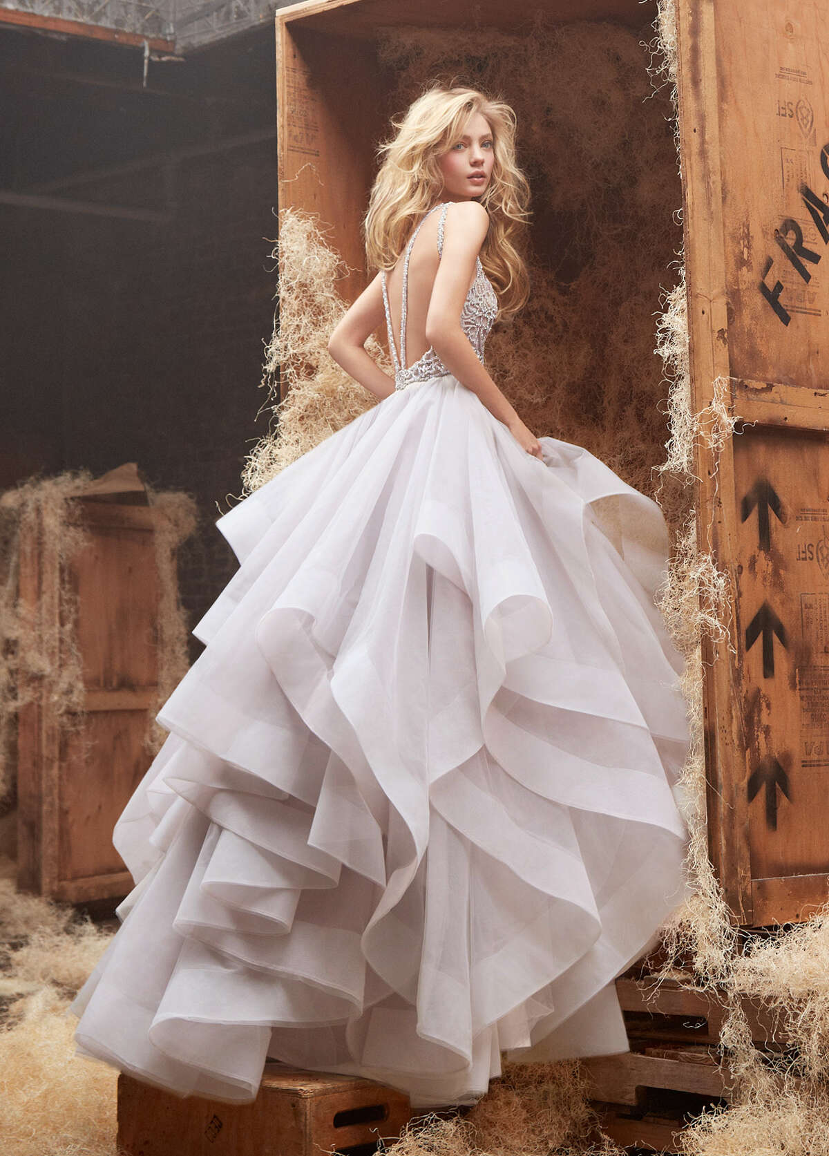 """The Hayley Paige """"Dori"""" bridal gown, $4,615, from Now & Forever Bridal Boutique on Kirby, has the drama that some brides want for their big day."""