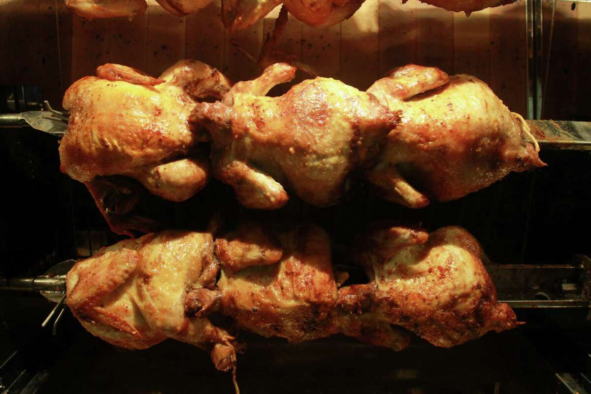 Chicken cooking in rotisserie oven at Local Foods.