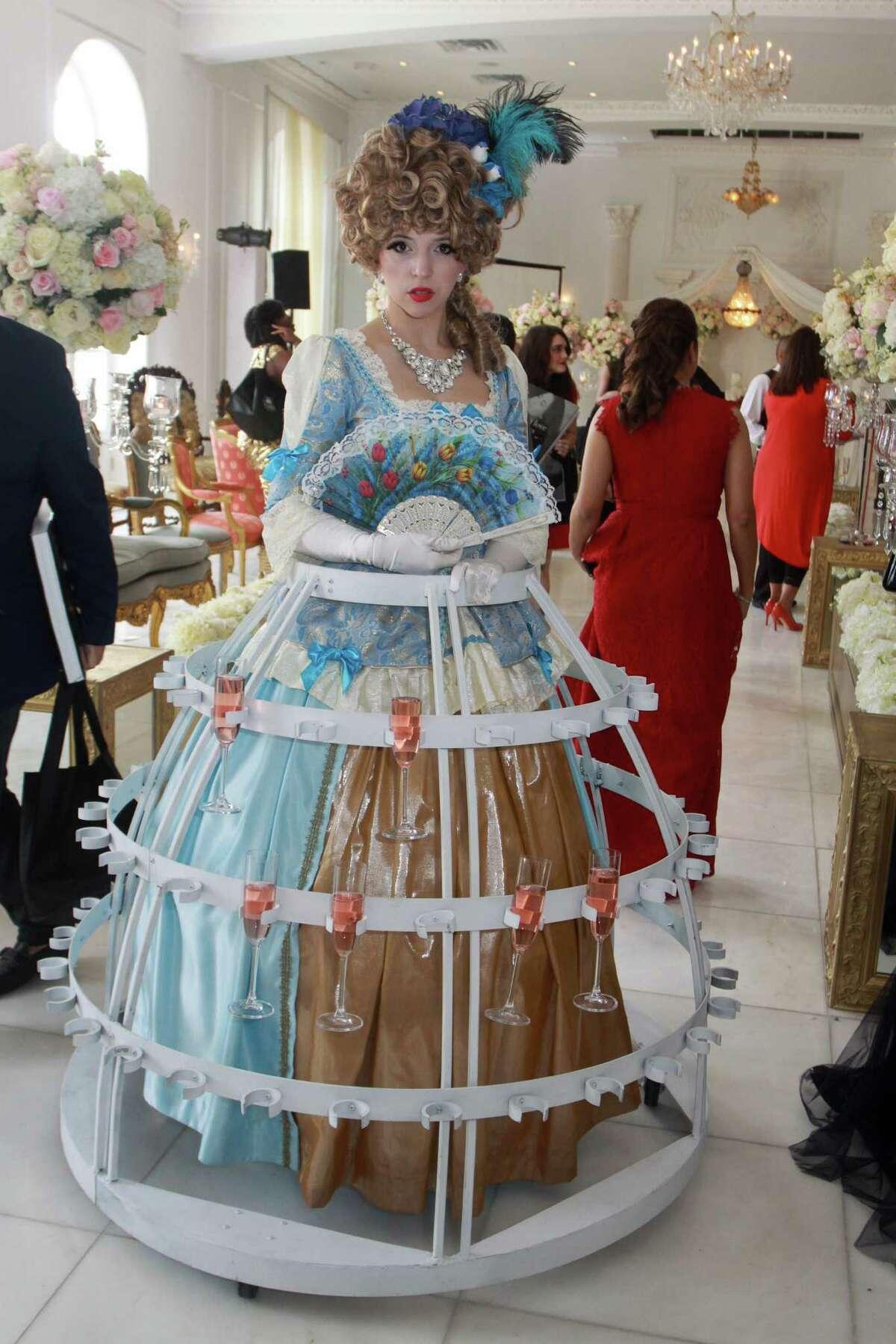 Madeline Kiley wears a champagne dress.