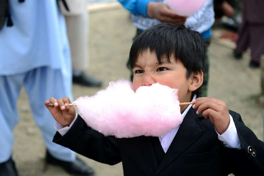 Care for some more ceiling insulation? A serious cotton candy eater gets down to business during Nowruz festivities in Kabul. Photo: Roberto Schmidt, AFP/Getty Images