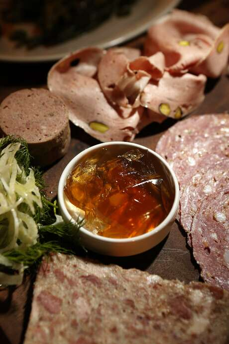 Trou Normand's charcuterie plate. Restaurants now serve more cheese and meat platters, which pair easily with cocktails. Photo: Carlos Avila Gonzalez, The Chronicle